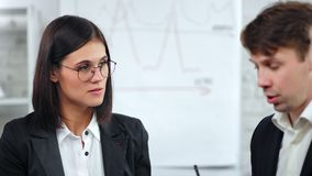 Close-up confident business female face in glasses listening colleague during corporate meeting