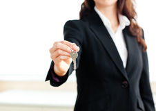 Close-up of a confident businesswoman holding key Stock Images
