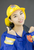 Close up of a confident lady firefighter showing thumbs up sign Royalty Free Stock Photos