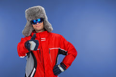 Close up of confident man standing in winter hat and coat. Stock Photography