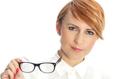 Close-up of a confident young businesswoman with glasses. In hand Royalty Free Stock Images