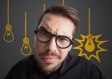 Close up of confused man with glasses against grey background with yellow lightbulb graphics. Digital composite of Close up of confused man with glasses against Royalty Free Stock Images