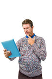 Close-up of confused man reading book Stock Photos