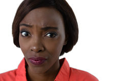 Close up of confused woman making face. Against white background Royalty Free Stock Photography