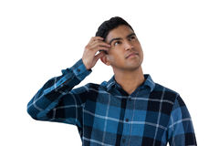 Close up of confused young man. Against white background Royalty Free Stock Photo