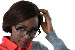 Close up of confused young woman wearing eyeglasses Stock Images