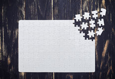 Close up of connecting puzzle with scattered pieces Royalty Free Stock Photography