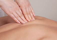 Close up of connective tissue massage on   muscle group. Close up of connective tissue massage on  a muscle group  of a womans back Royalty Free Stock Image