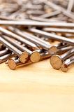 Close-up of construction nails on wood Royalty Free Stock Photos