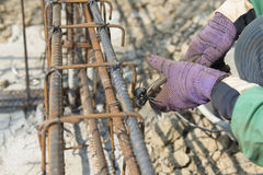 Close up of construction worker hands working with pincers Royalty Free Stock Images