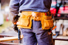 Close-up of construction worker with tool bag, rear view Stock Photo