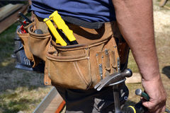 Close up of construction worker with tool belt Royalty Free Stock Photo