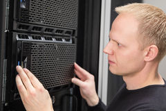 Close-up of It consultant installing server in datacenter Stock Photos