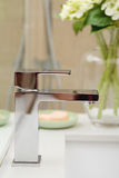 Close up of a contemporary square shaped mixer tap Royalty Free Stock Photos