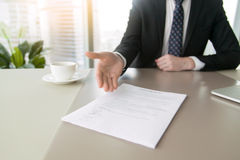 Close up of a contract to sign. Close up of a contract proposing to sign, full and accurate details, individual who owns the business sign personally, director royalty free stock photo