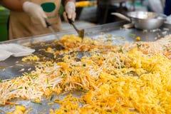 Close up of cook frying wok at street market Royalty Free Stock Photos