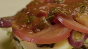 Cook Prepares Hamburgers Pour Sauce On The Top. Close-up - Cook Prepares Hamburgers Pour Sauce On The Top With Tomato Cheese And Meat. Cafe Menu stock footage