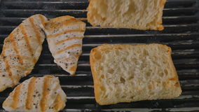 Close-up - the cook turn the bread on a grill pan stock video