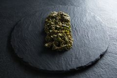 Close-up of cooked kale in slate on table Royalty Free Stock Photos