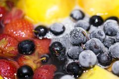 Close-up of cooking compote drink from fresh and frozen fruits and berries. Non-alcoholic tasty punch drink stock images