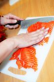 Close up cooking fish in domestic kitchen Royalty Free Stock Image