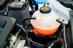 Close up Coolant container in a carengine bay. Close up Coolant container in a car engine bay Royalty Free Stock Images