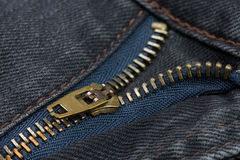 Close-up of a copper color zipper with black jeans Royalty Free Stock Photography