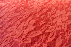 Close up of coral red guipure with floral pattern Stock Photo