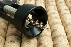 Close-up corkscrew on wine corks background Royalty Free Stock Images