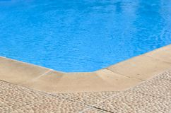Close-up corner of swimming  pool at noon. In a  resort hotel  garden royalty free stock image