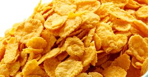 Close up of cornflakes. Children's breakfast:  heap of cornflakes on plate Stock Photos