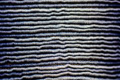 Close up corrugated blue jeans pattern texture. Royalty Free Stock Images