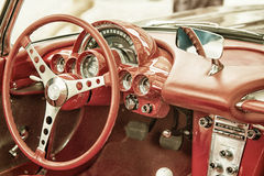 Close up on Corvette vintage car steering wheel and cockpit Royalty Free Stock Photography