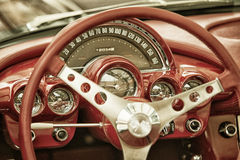 Close up on Corvette vintage car steering wheel and cockpit Stock Photos