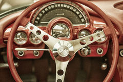 Close up on Corvette vintage car steering wheel and cockpit Stock Images