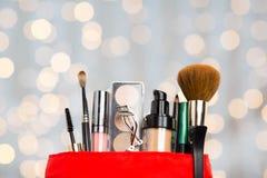 Close up of cosmetic bag with makeup stuff Stock Photos