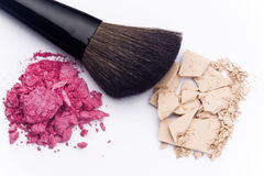 Close up of cosmetic products. Close up of facial powder and blush with cosmetic brush Royalty Free Stock Image