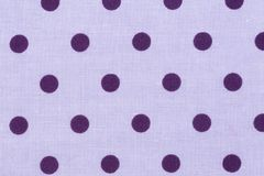 Cotton fabric with purple dots, abstract background. Close up of cotton fabric with purple dots, abstract background Royalty Free Stock Photography