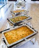 Close up countertop food warmer and dish on table stock image