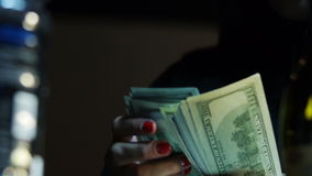 Close-up of a Counting Hundred  Dollar Bills stock video