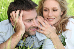 Close-up of a couple. Portrait of a couple lengthened in the grass Royalty Free Stock Photography