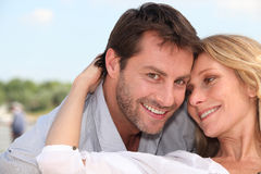 Close-up of a couple. Close-up of an amourous couple outdoors Stock Photography