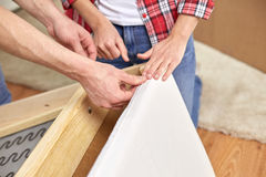 Close up of couple assembling furniture at home Royalty Free Stock Photo