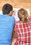 Close up of couple with  blueprint at home Stock Photo