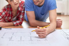 Close up of couple with  blueprint at home Stock Images