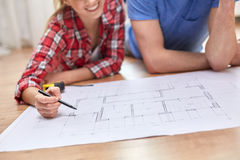Close up of couple with  blueprint at home Royalty Free Stock Photo