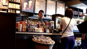 Close up couple buying coffee and paying by credit card stock video footage