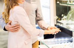 Close up of couple choosing ring at jewelry store Royalty Free Stock Images