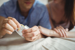 Close-up of couple with a condom on bed Royalty Free Stock Image