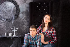 Close Up of Couple in Creepy High Back Chair Royalty Free Stock Photo